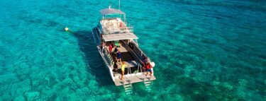little cayman dive boat on reef 1060x403 min