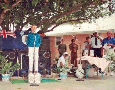 Michael Tibbetts as MC for Little Cayman Beach Resort grand opening in 1993